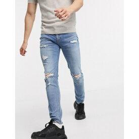 エイソス メンズ デニムパンツ ボトムス ASOS DESIGN skinny jeans in mid wash with heavy rips Mid wash blue