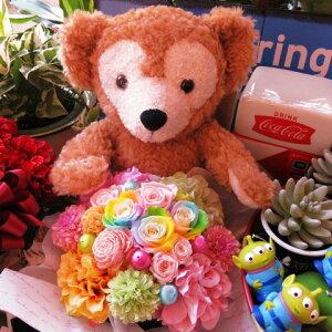 クリスマスプレゼント ダッフィー ぬいぐるみ ダッフィーがお花を抱えた サプライズ ダッフィー レインボーローズ プリザーブドフラワー入り ◆大切なあの人を笑顔にしちゃう魔