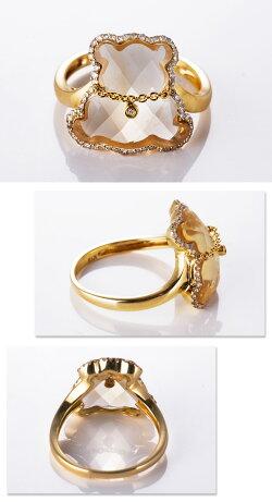 ダイヤモンドのプチネックレスをした艶やかなシトリンの美しいカットのイエローくまちゃんリング