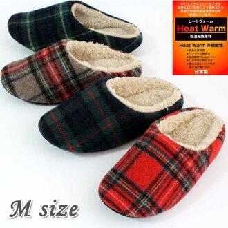 溫暖的房間裡鞋刷格子軟   時尚的室內鞋類產品熱暖熱產生的材料。
