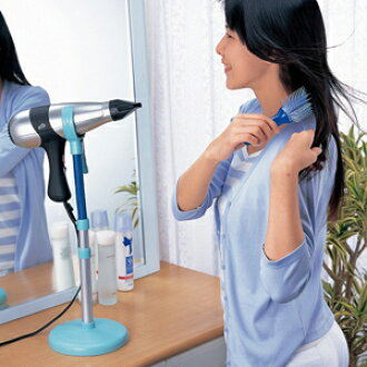 With a handy hair dryer stand use of hands