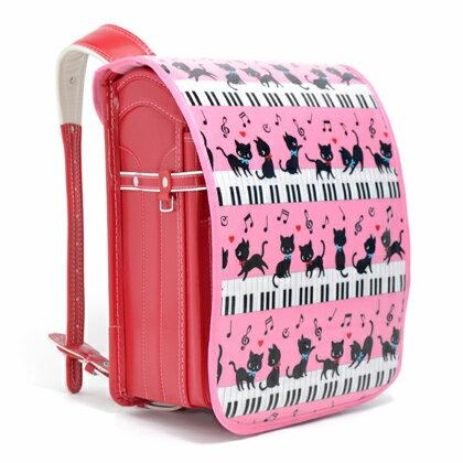 ランドセルカバー ピアノの上で踊る黒猫ワルツ(ピンク) (ランドセルカバー 女の子 ランドセル カバー 雨 撥水 かわいい おしゃれ セイバン 天使の羽 ラブピ モデルロイヤル ワンパ ピアノ 猫 ピンク)