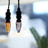 日に透けたガラスの色が美しいシャンデリア電球。口金E17