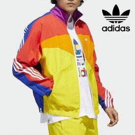 《即納》【SALE10%OFF】アディダスオリジナルス adidas originals PRIDE OFF CENTER JACKET レディース ジャケット ウインドブレーカー ジャージ 羽織り トップス プライド LGBT スポーツ 運動 ジム ランニングウェア カラフル 派手 izc94