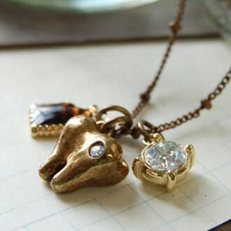 Is a cake enthusiast attention to a cavity? A real tooth and the half-eaten cookie that Swarovski shines are accessories ◆ tooth cookie necklaces of the motif