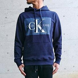 Calvin Klein カルバン・クライン スウェット パーカー NAVY (ネイビー) メンズファッション プルオーバーパーカー プリントパーカー 大人カジュアル ストリート ビッグシルエット オーバーサイズ ユニセックス レディース ペアコーデ