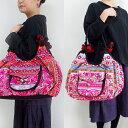 モン族刺繍ラウンドバッグ モン族のカラフルな刺繍布を両面に使った、アジアンエスニックテイストのトートバッグ アジアン雑貨