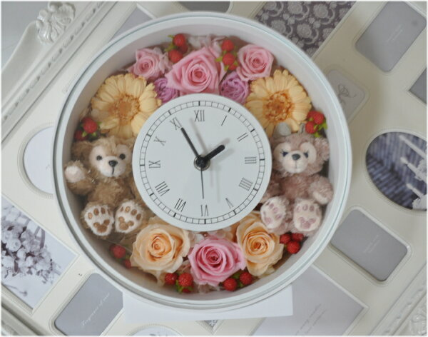 **結婚祝いにいかが?ディズニーシー★ダッフィー&シェリーメイがついたデザインおまかせ時計丸。置時計。プレゼントにおすすめ!プリザーブドフラワー結婚祝い