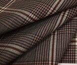 グレー地にエンジのラインがアクセントのグレンチェック調チェック柄生地。薄手のウール/ポリエステル混先染めサマーウール(平織り)生地