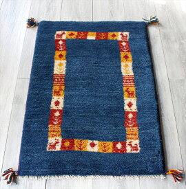 ラグ・ギャッベ(ギャベ)カシュカイ族の手織りラグ・玄関マットサイズ88x61cm ブルー・カラフルタイル・動物と植物モチーフ