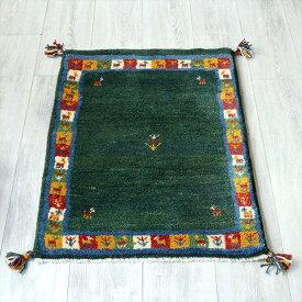 ラグ・ギャッベ(ギャベ)カシュカイ族の手織りラグ・玄関マットサイズ85x61cm グリーン・カラフルボーダー・動物と生命の樹