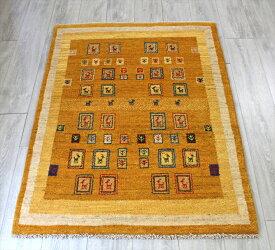 ギャッベ/ギャベ・カシュカイ族の手織りラグ・アクセントラグサイズ144x103cm マスタードイエロー カラフルなタイル柄 動物のモチーフ