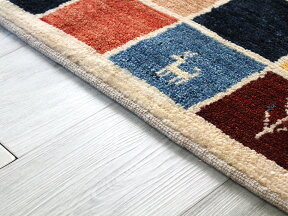 ギャッベ/ギャベ・カシュカイ族の手織りラグ・センターラグサイズ188x114cmカラフルなタイル柄動物・植物・子供のモチーフ