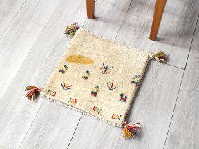 ギャッベ・イラン製手織り座布団サイズ39x40cmナチュラルアイボリー・太陽と動物と植物のモチーフ