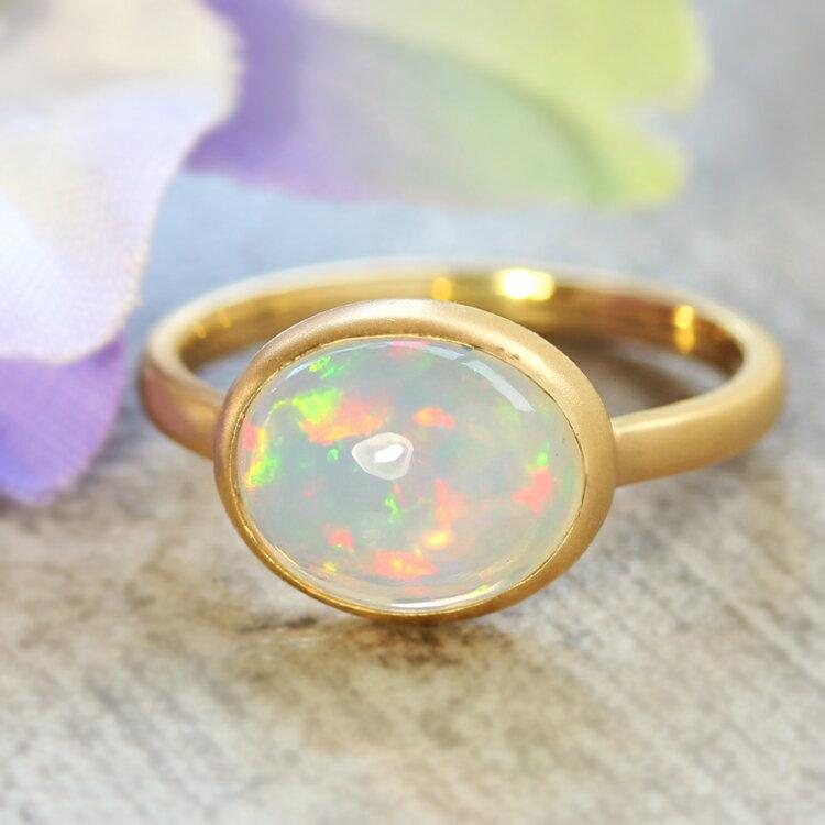 エチオピア産オパール リング 10K イエローゴールド レディース 指輪・ハウ 大粒 ボリュームリング K10 10金 ファッションリング 10月の誕生石リング 虹色 ジュエリー ブランド 一粒リング 宝石 おしゃれ