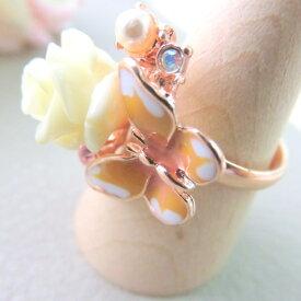 エポ使いのパステル色のピンクゴールド ブーケリング。きれいな蝶がとまった花束のような美しいボリューム感のある華やか 可愛い リング。 メール便送料無料母の日 クリスマス