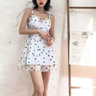 It is a random monotone square dot frill dress swimwear