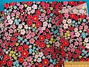 綿プリント生地小花/リボン・黒×ピンク