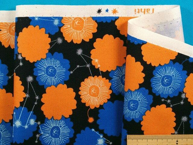綿プリントオックス生地星座(獅子座)黒×オレンジ