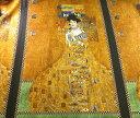 綿パネルプリント生地(ROBERT KAUFMAN)女性・茶系×黒×金(108cm×240cm)