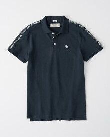 Abercrombie&Fitch (アバクロンビー&フィッチ) 正規品 テープロゴ ストレッチ鹿の子半袖ポロシャツ (Logo Tape Stretch Polo) メンズ (Navy Blue) 新品 日本未発売