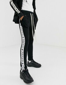 プロファウンドエステティック メンズ カジュアルパンツ ボトムス Profound Aesthetic track stripe joggers in black Black