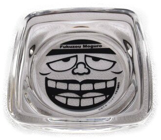 An ashtray black もぐろふくぞうの face of the laughing salesman is real.