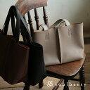 バッグ 革を贅沢に使用したような、上品な一枚革風トート。一枚革風フェイクレザートートバッグレディース/鞄/合皮/エ…