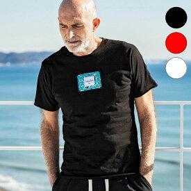 1PIU1UGUALE3 RELAX ウノピゥウノウグァーレトレ × Christie Shinn クリスティ・シン アイランド ワッペン メンズ Tシャツ 半袖 トップス おしゃれ かっこいい ブランド ウノピュウ