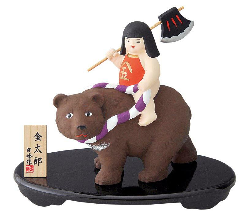 陶器製 武者人形・日本人形 金太郎熊乗り 菱形の腹掛けを着け、熊に跨(またが)り、鉞(マサカリ)を担いだ金太郎です!