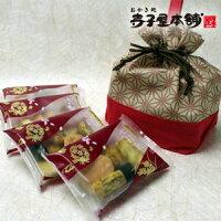 『華舞(はなまい)』「人気のおかき七彩菓4袋を和柄巾着に入れました」