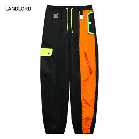 【30%OFFセール】LANDLORD NEW YORK (ランドロード) SPACE COLONY TRACK PANTS (MULTI/BLACK) [トラックパンツ ジョガーパンツ パラシュートパンツ カーゴパンツ ボトムス ブランド ミリタリー ストリート メンズ ユニセックス] [マルチ/ブラック]